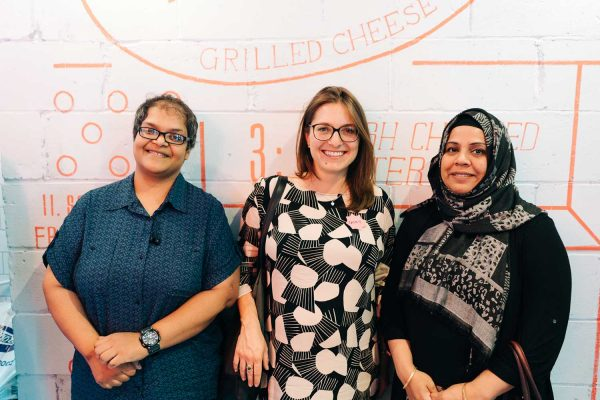 Digital mentor with two female Asian business owners