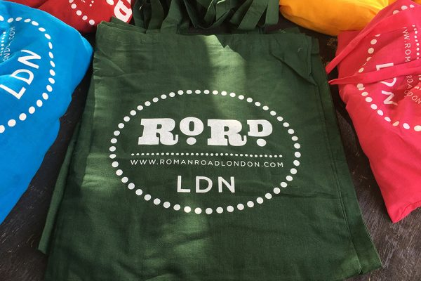 Roman Road logo on shopping tote bag