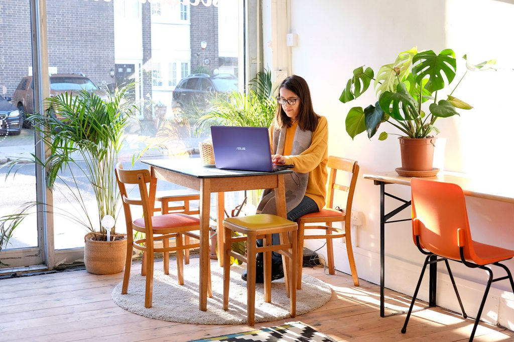 Woman hotdesking at Social Streets Co-Lab coworking space on Roman Road